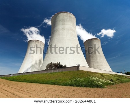Nuclear power plant Dukovany - cooling towers, field and beautiful sky - Czech Republic - stock photo