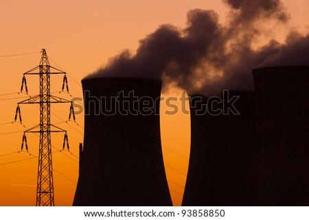 Nuclear power plant during sunset - stock photo