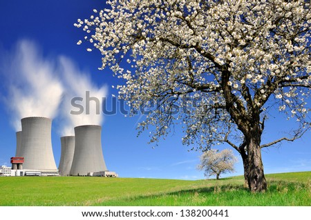 Nuclear power plant in spring landscape - stock photo