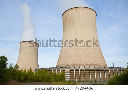 Nuclear Power Plant in the middle of the forest - stock photo