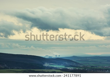 Nuclear power plant Mochovce and dramatic sky in Slovak republic. Landscape photo. - stock photo
