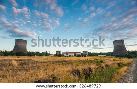 nuclear power plant on sunset time. - stock photo