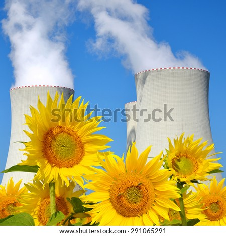 Nuclear power plant Temelin with sunflowers in Czech Republic Europe - stock photo