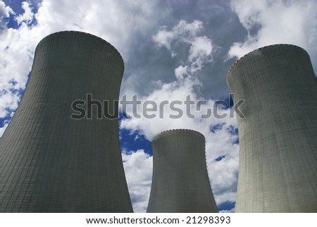 Nuclear power plant tower against the sky - stock photo