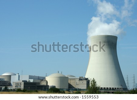 Nuclear power plant with cooling tower - stock photo