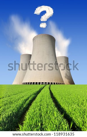 Nuclear power plant with question mark from clouds - stock photo