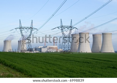 Nuclear power station, Dukovany, Czech Republic - power lines and cooling towers, containment buildings, green grassy field in foreground