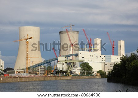 Nuclear power station on the river bank - stock photo