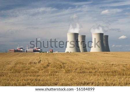 Nuclear power station, Temelin, Czech Republic - cooling towers, containment buildings, gold stubble-field in foreground