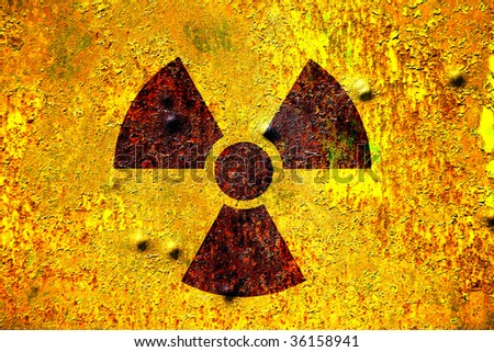 nuclear radiation sign background in toxic yellow - stock photo