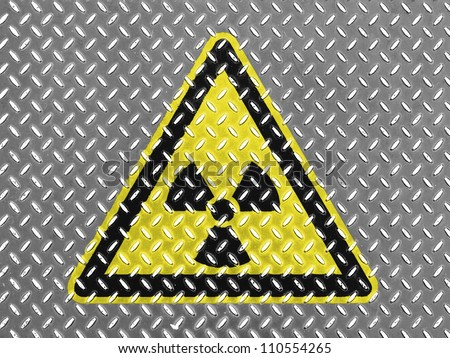 Nuclear radiation sign drawn on metal floor - stock photo