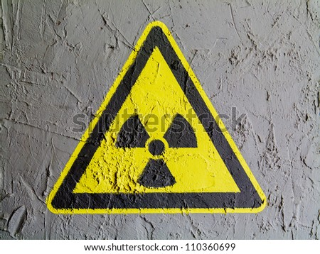 Nuclear radiation sign drawn on wall - stock photo