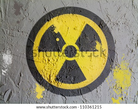 Nuclear radiation symbol painted on wall - stock photo