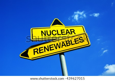 Nuclear - Renewables - Traffic sign with two options - deciding between atomic and alternative electricity ( solar energy, wind ) . Question of waste, safety, danger, effectiveness, ecology - stock photo