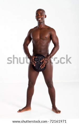 nude african american man covering private part with a hat - stock photo
