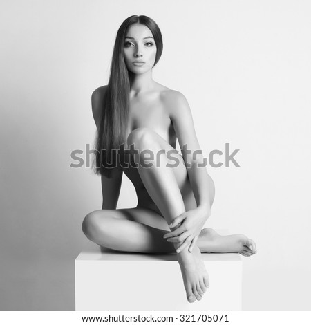 nude beautiful young woman. sexy girl with long hair - stock photo