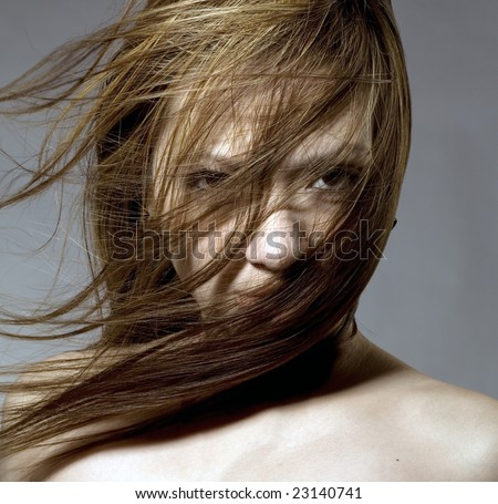 Nude beauty model in studio with hair blown by wind - stock photo