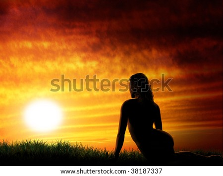 Nude girl and beautiful sunset - stock photo