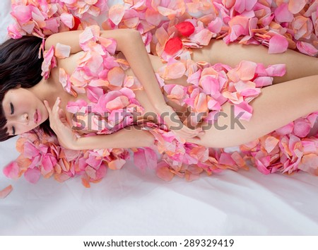 nude Girl in flower sexy - stock photo