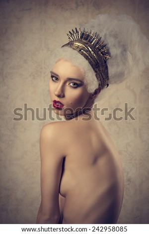 nude glamour woman with cute make-up posing with artistic crazy hair-style and golden accessories  - stock photo