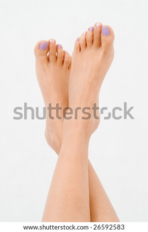 nude legs isolated on white - stock photo