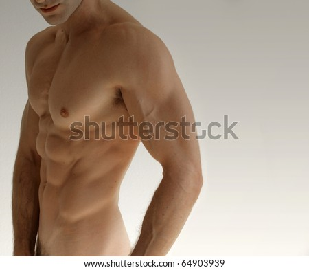Nude sexy male model against neutral background - stock photo