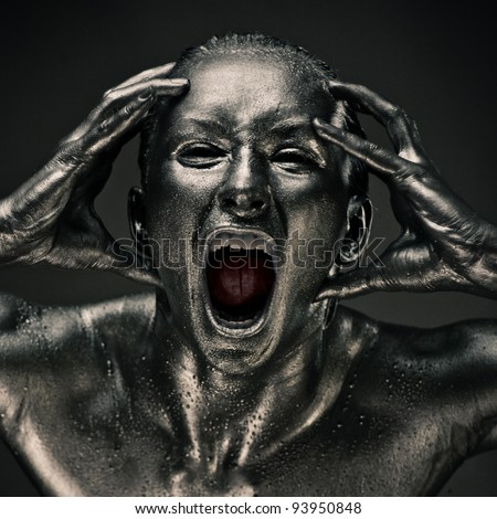Nude woman like statue in liquid metal screaming