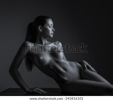 Nude woman, sexy, erotic background. Naked sensual body isolated on black. - stock photo