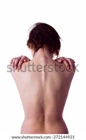 Nude woman with a shoulder injury on white background - stock photo