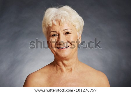 Nude 60 year old spa woman- head and shoulders - stock photo