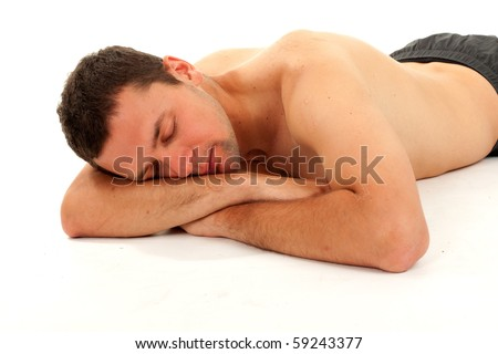 nude young man sleeping on the floor with leaning on hands head - stock photo