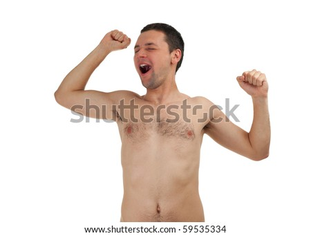 nude young man standing, yawning and stretching , isolated