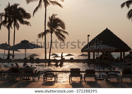 NUEVO VALLARTA, MEXICO - NOV.23, 2015: New Puerto Vallarta is popular  tourists destination. Beautiful beaches and clear warm water of the North Pacific Ocean are attractive to swimmers all year round - stock photo