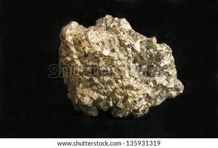 Nugget of mineral iron pyrite also known as fool's gold because of its resemblance to gold. Concept for business, wealth, greed, mining or geology. - stock photo