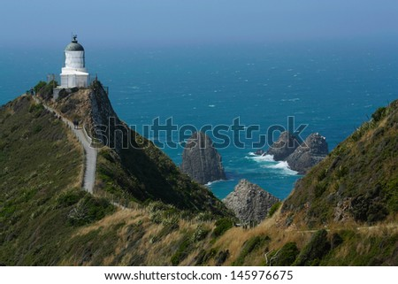 Nugget point lighthouse - stock photo