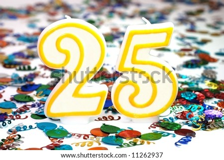 Number 25 celebration candle with confetti.
