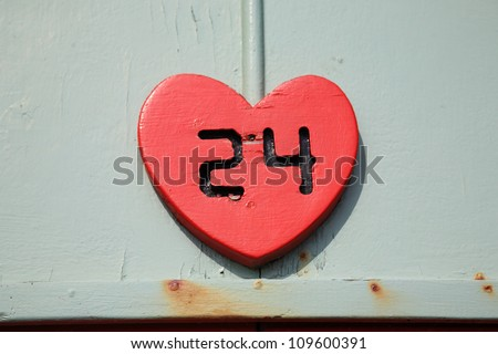 Number 24 cut into a red heart shape England - stock photo
