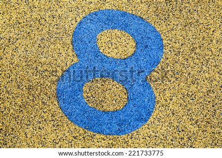 Number Eight sign on sand fome ,safety floor on playground. - stock photo