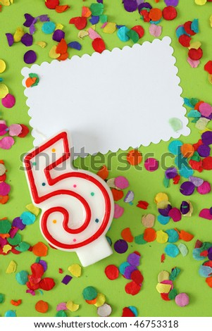 Number five birthday candle on green background - stock photo