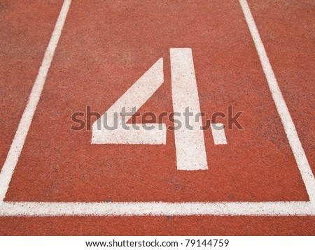 Number four on the start of a running track