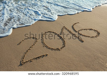 Number 2016 handwritten on seashore sand. Concept of upcoming new year and passing of time. - stock photo