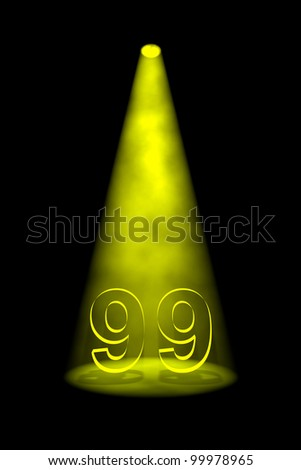 Number 99 illuminated with yellow spotlight on black background - stock photo