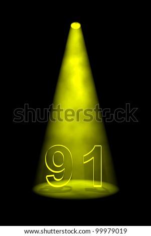 Number 91 illuminated with yellow spotlight on black background - stock photo
