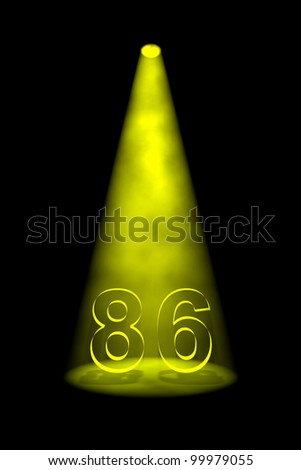 Number 86 illuminated with yellow spotlight on black background - stock photo
