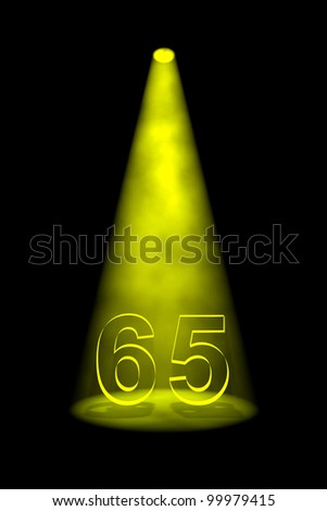 Number 65 illuminated with yellow spotlight on black background - stock photo