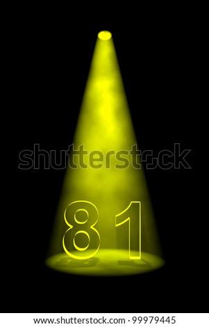 Number 81 illuminated with yellow spotlight on black background - stock photo