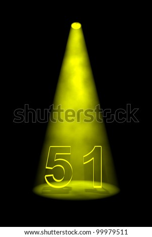 Number 51 illuminated with yellow spotlight on black background - stock photo