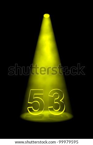 Number 53 illuminated with yellow spotlight on black background - stock photo