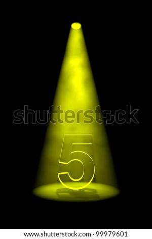 Number 5 illuminated with yellow spotlight on black background - stock photo