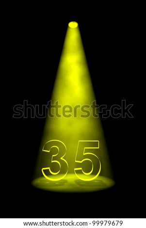Number 35 illuminated with yellow spotlight on black background - stock photo